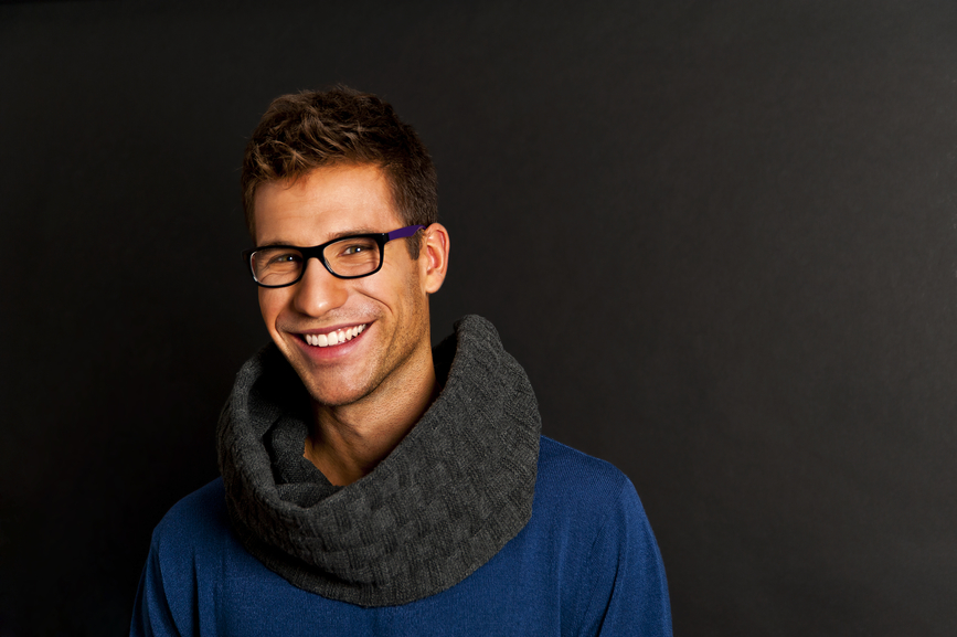 Handsome man with scarf on black background